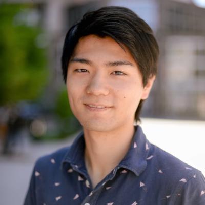 Haruki Moriguchi, a member of the tech team, stands in a blue collared shirt