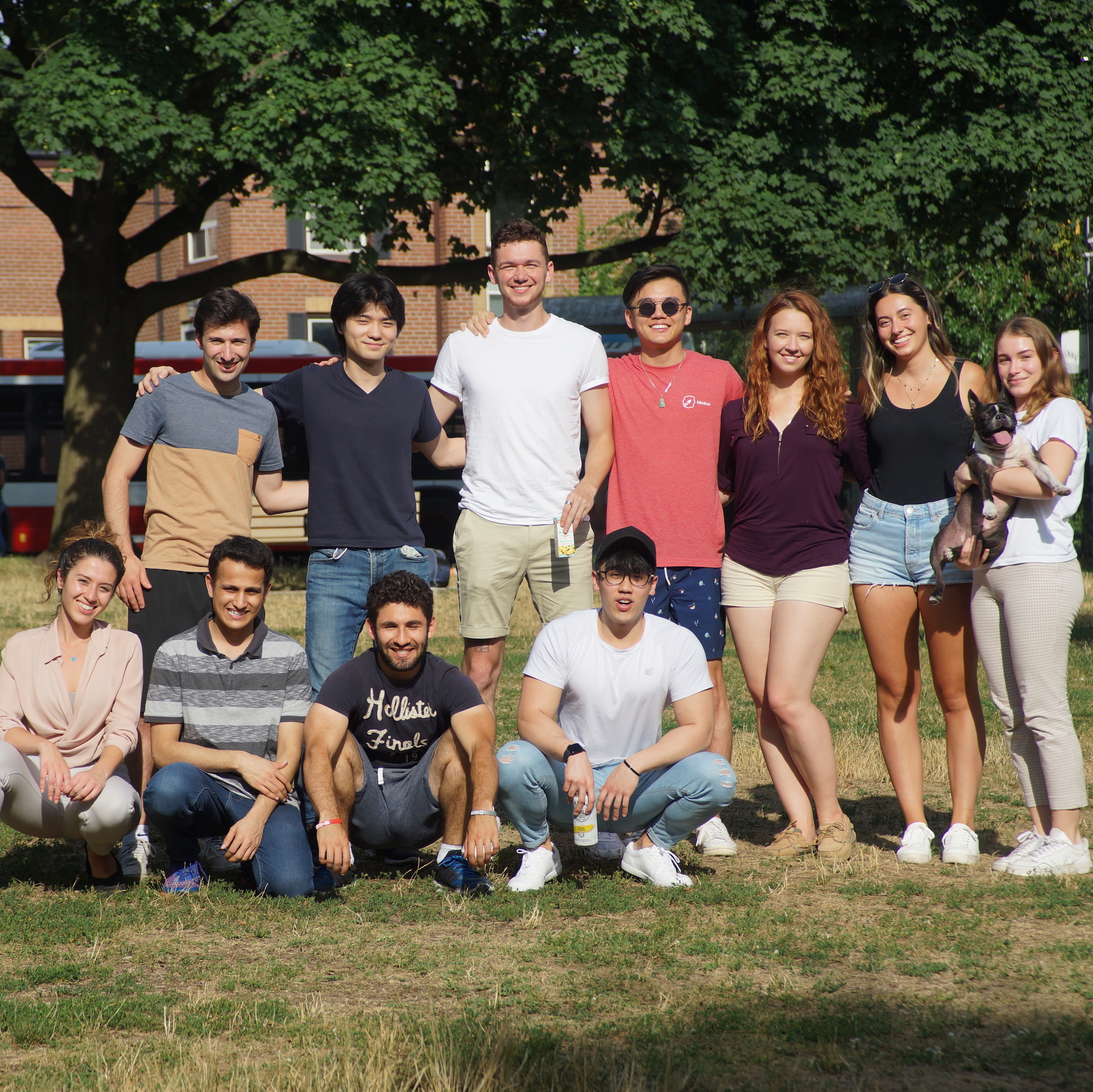The Nimbus team stands arm in arm, smiling for the camera